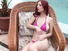 Redhead babe looses bikini and masturbates