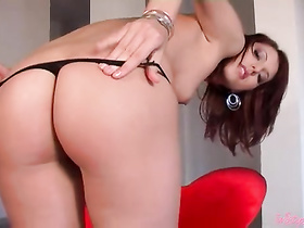 Sexy redhead in tiny thong plays with a dildo