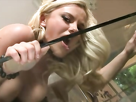Blonde sits on glass table bare ass and strokes pussy