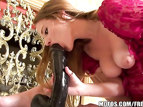 Naughty babe is playing with giant dildos
